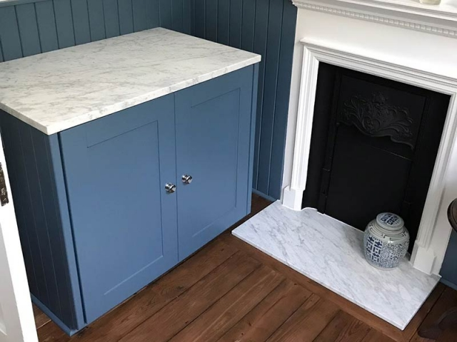 Marble fireplace and cuboard worktop